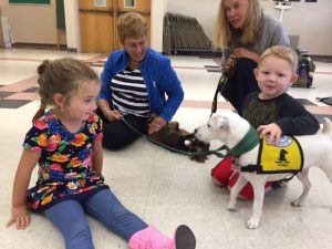 pet-therapy-skaneateles-parsons-dachund-sitting-with-friends